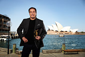 American actor John Travolta poses during a photo shoot at the Park Hyatt in Sydney New South Wales