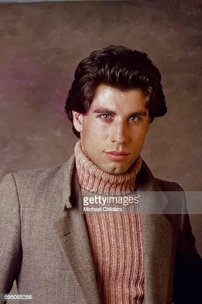 American actor John Travolta wearing brown turtleneck sweater and blazer