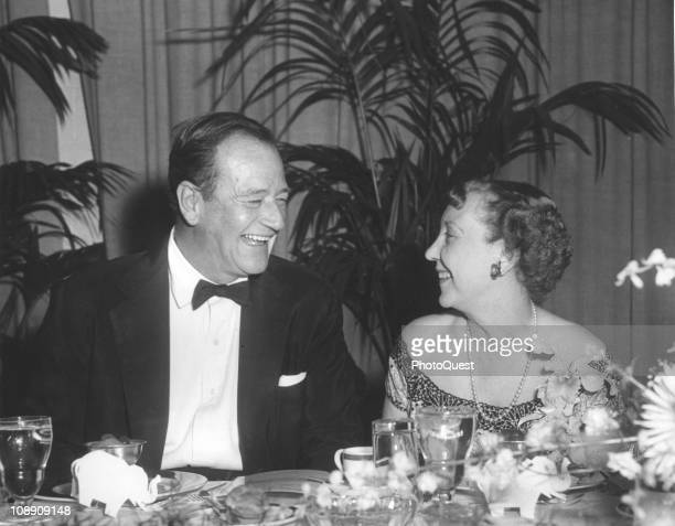 American actor John Wayne and US First Lady Mamie Eisenhower attend a dinner in honor of Congressional Republicans at the Sheraton Hotel Washington...