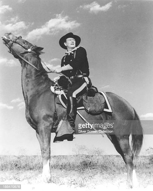 American actor John Wayne on horseback and in US Cavalry uniform circa 1955