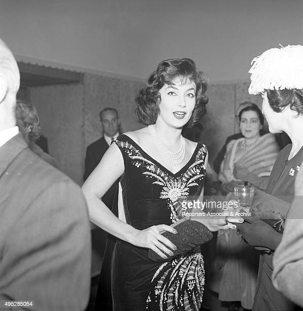 American actor John Wayne 's wife Pilar Pallete posing at the cocktail for the end of the shooting of the film Legend of the Lost 1957