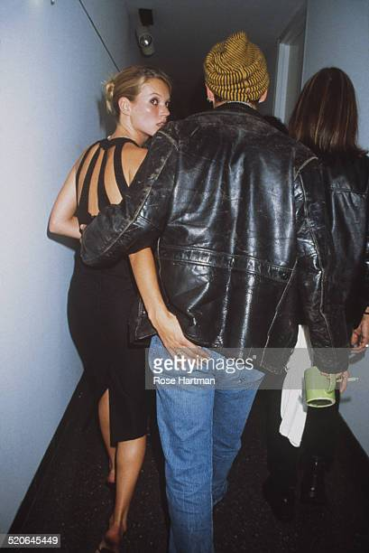 American actor Johnny Depp dressed in a leather jacket and knit cap with Kate Moss at the James Danziger Gallery for an opening to premiere 'The Kate...