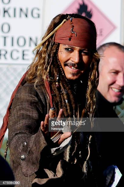 American actor Johnny Depp greets locals as he arrives at Raby Bay Cleveland in Redland City Queensland during the filming of 'Pirates of the...