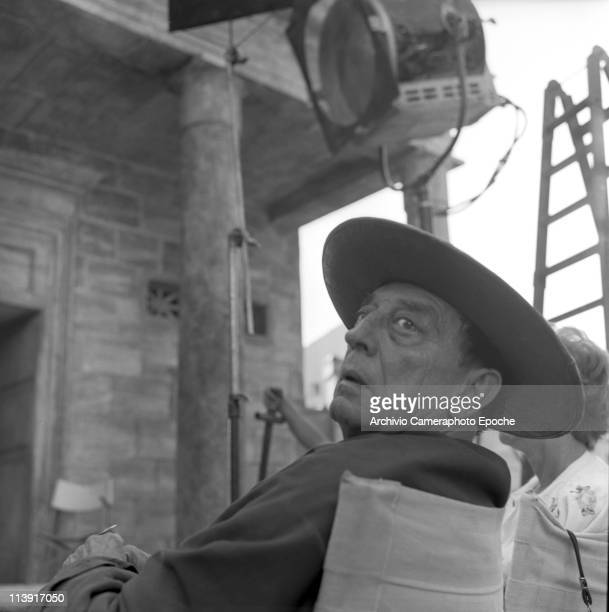 American actor Joseph 'Buster' Keaton wearing a hat sitting on a chair on the set of the movie ' A Funny Thing Happened on the Way to the Forum' Rome...