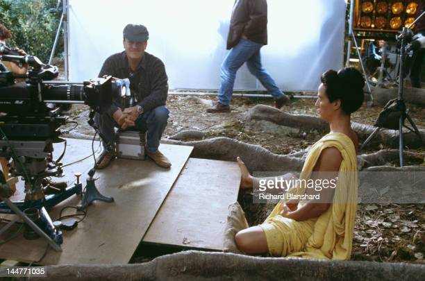 American actor Keanu Reeves stars as Siddhartha Gautama who later became known as the Buddha in the film 'Little Buddha' circa 1992 Here he prepares...
