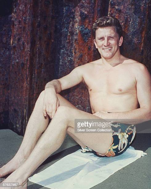 American actor Kirk Douglas in swimming trunks circa 1955
