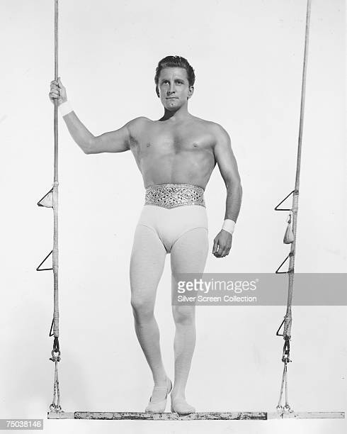 American actor Kirk Douglas stars as trapeze artist Pierre Narval in the MGM film 'The Story of Three Loves' 1953
