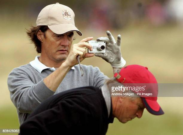 American actor Kyle MacLachlan takes a photograph during the second round match with Michael Douglas of the Dunhill Links Championships at St Andrews...