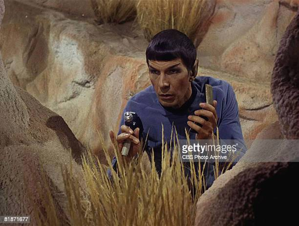 American actor Leonard Nimoy as Mr Spock holds a phaser in a scene from 'The Man Trap' the premiere episode of 'Star Trek' which aired on September 8...