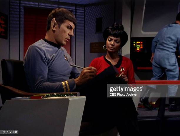 American actor Leonard Nimoy speaks to actress Nichelle Nichols on the bridge of the USS Enterprise in a scene from 'The Man Trap' the premiere...