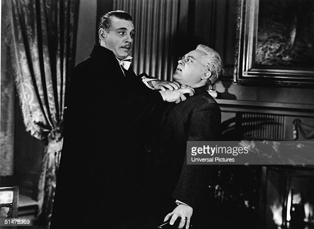 American actor Lon Chaney Jr as Count Alucard reaches out to strangle vampire hunter Professor Laszlo as played by Hungarianborn Americna actor J...
