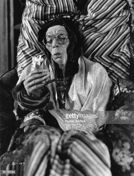 American actor Lon Chaney plays the part of an ancient mandarin in his latest film 'Mr Wu' directeed by William Nigh for MGM