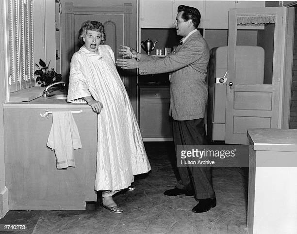 American actor Lucille Ball reacts to Cubanborn actor Desi Arnaz in a still from the television show 'I Love Lucy' 1956