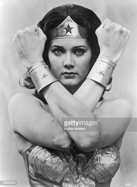American actor Lynda Carter crosses her arms in front of her face in a promotional portrait for the television series 'Wonder Woman' She wears a...