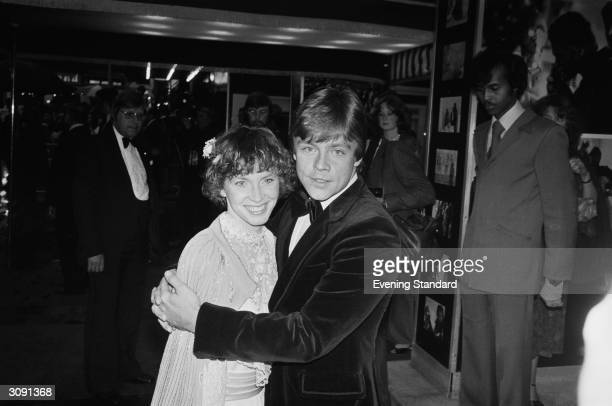 Actor Mark Hamill who played Luke Skywalker in the 'Star Wars' series of films attending the royal premiere of 'The Empire Stikes Back' with his wife...