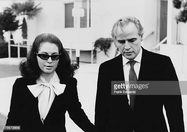 American actor Marlon Brando leaves the Santa Monica courthouse with his attorney Judy Gilbert during a legal battle with his wife Anna Kashfi for...