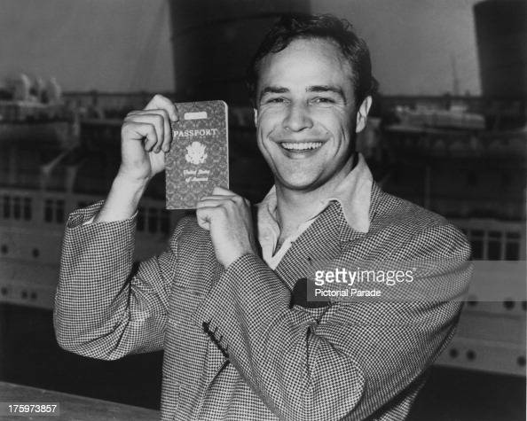 American actor Marlon Brando proudly displays his US passport as he prepares to sail for Europe 1953