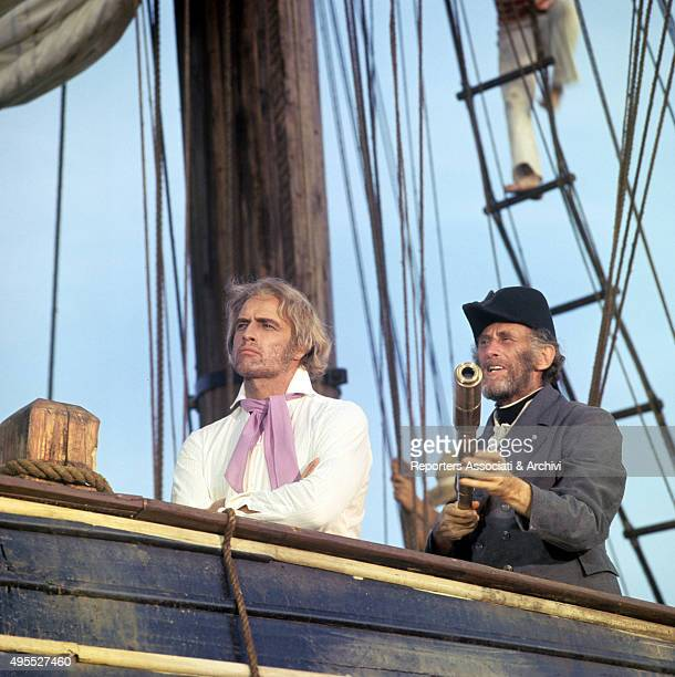 American actor Marlon Brando standing on the deck of a ship beside un unknown actor on the set of the film 'Queimada' 1969