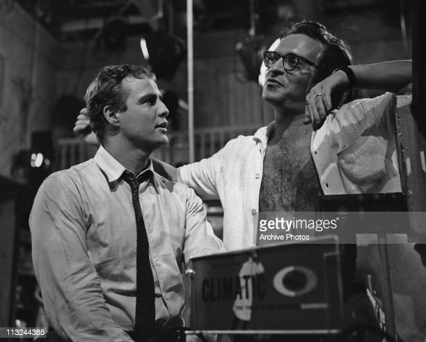 American actor Marlon Brando with director Sidney Lumet on the set of the 1960 film 'The Fugitive Kind'