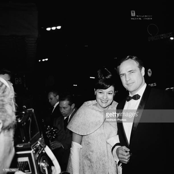 American actor Marlon Brando with his wife actress Movita Castaneda at the premiere of Brando's film 'The Mutiny on the Bounty' USA November 1962