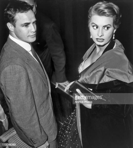 American actor Marlon Brando with Italian actress Sophia Loren at an award ceremony in Rome Italy in 1954