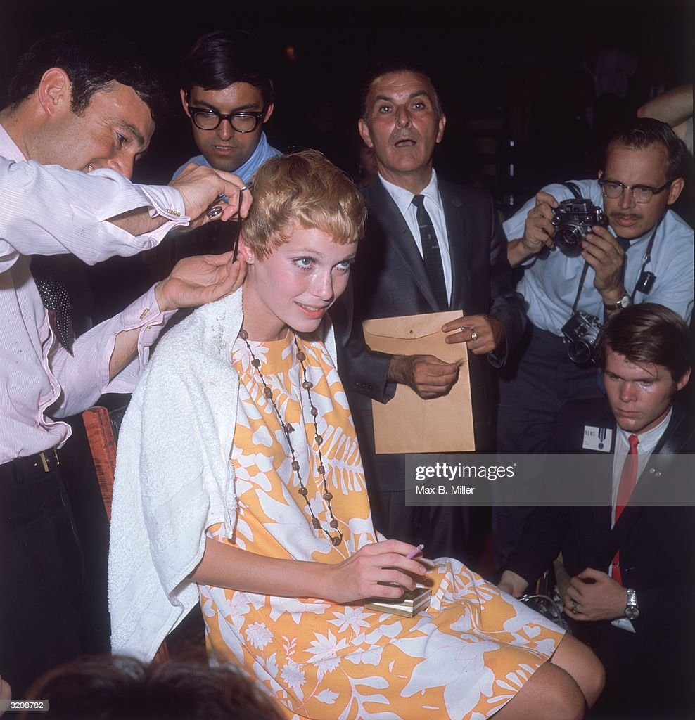 American actor Mia Farrow gets a haircut by stylist VIdal Sassoon while surrounded by photographers.