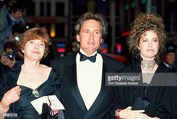 American actor Michael Douglas attending the premiere of Oliver Stone's film 'Wall Street' with his wife Diandra right and another guest 27th April...