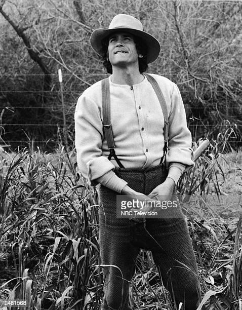 American actor Michael Landon stands in a field in a still from the television series 'The Little House On The Prairie' circa 1976