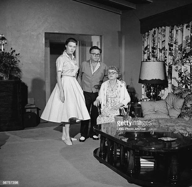 American actor Mickey Rooney poses with his wife Elaine Devry and mother Nell Yule on a episode of the Edward R Murrowhosted interview show 'Person...