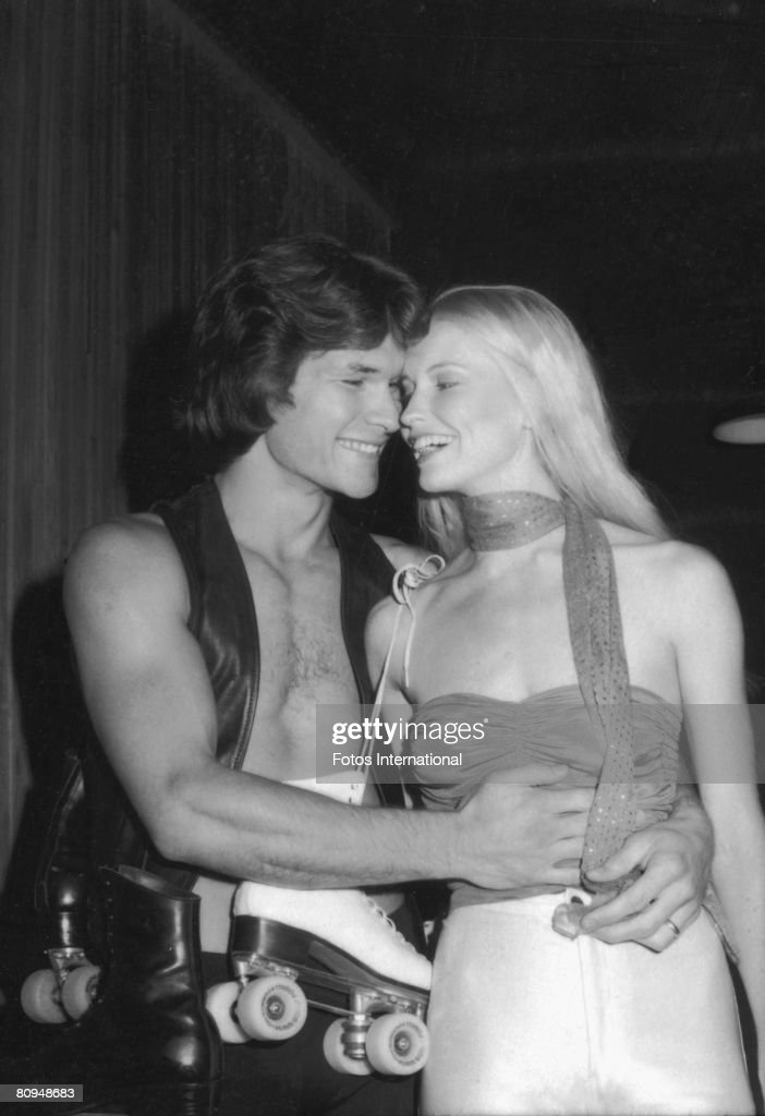 American actor Patrick Swayze shares a laugh with his wife, dancer and actress Lisa Niemi (born Lisa Haapaniemi) at the premiere party for the movie 'Skatetown USA' at Flippers roller rink, Los Angeles, California, October 1979.