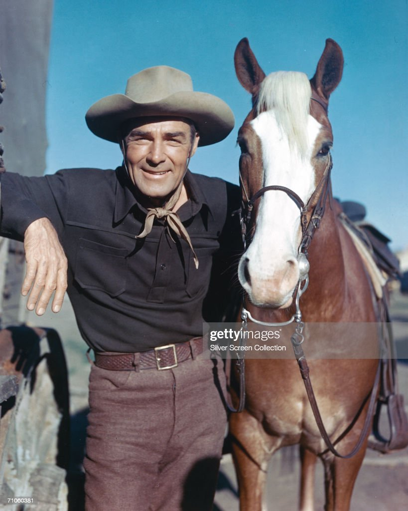 American actor Randolph Scott (1898 - 1987) with his palomino horse, Stardust, circa 1960.