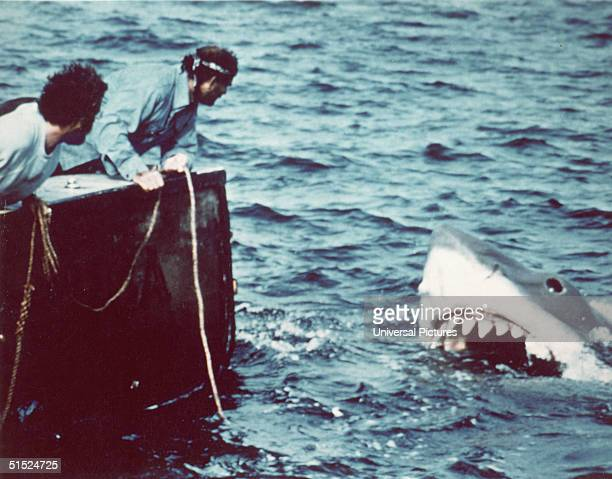 American actor Richard Dreyfuss and British author and actor Robert Shaw look off the stern of Quint's fishing boat the 'Orca' at the terrifying...