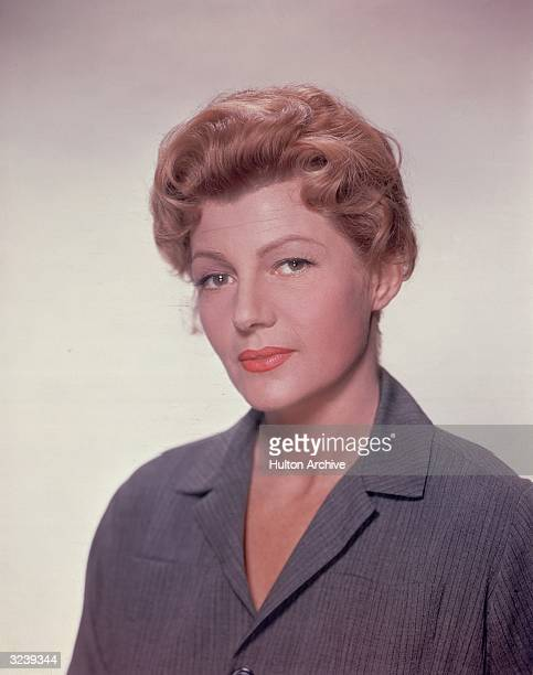 American actor Rita Hayworth wears a striped gray prison smock in a promotional headshot portrait for director Clifford Odets's film 'The Story on...