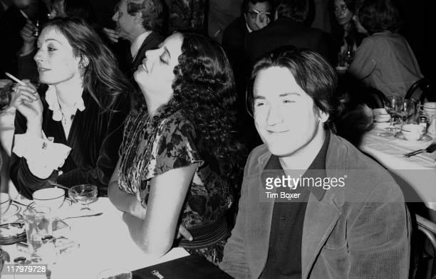 American actor Robert De Niro sits with his wife Diane Abbott and actress Anjelica Huston at the New York Film Critics Awards dinner at Sardi's...