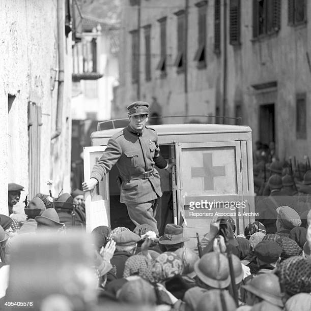 American actor Rock Hudson standing on an Italian Red Cross van in a scene from the film A farewell to arms Italy 1957