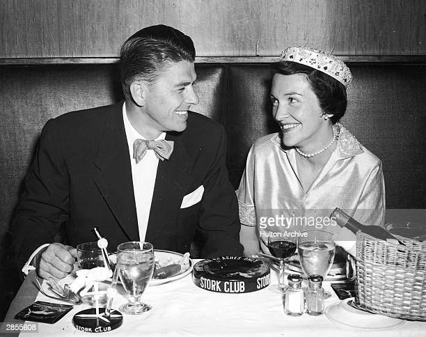 American actor Ronald Reagan and his wife Nancy Reagan smile as they have their honeymoon dinner at the Stork Club New York City 1952