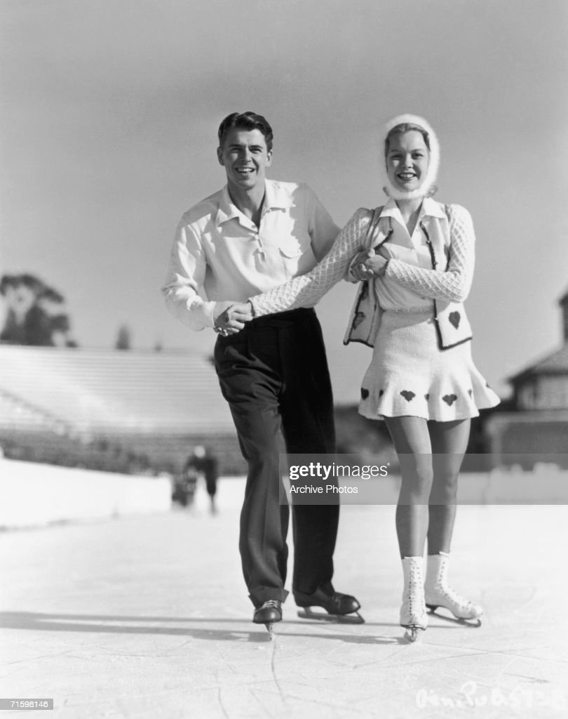 American actor Ronald Reagan (1911 - 2004) ice skating with his wife, actress Jane Wyman, circa 1945.