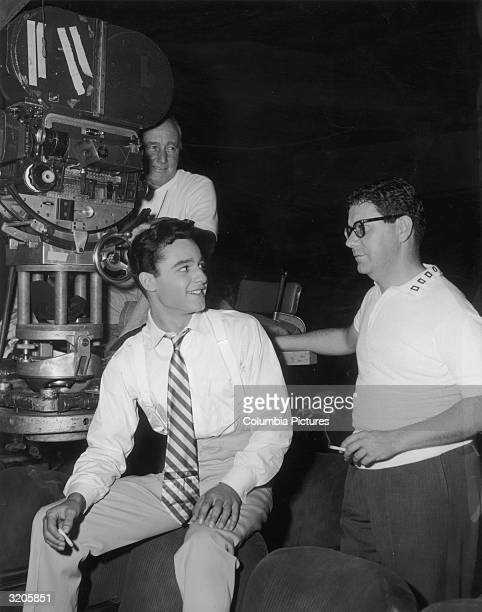 American actor Sal Mineo talks with film director Don Weis on the set of his film 'The Gene Krupa Story' starring Mineo Cinematographer Charles...
