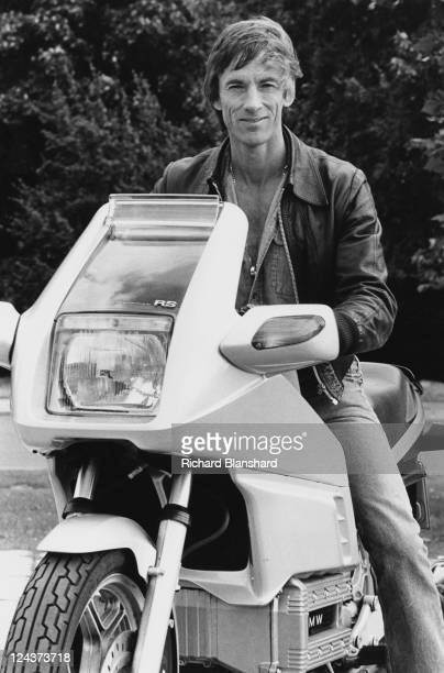 American actor Scott Glenn rides a BMW motorcycle on the set of the film 'Wild Geese II' 1985