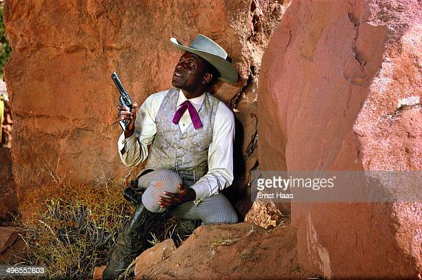 American actor Sidney Poitier on the Utah set of the film 'Duel at Diablo' during the ambush scene 1966