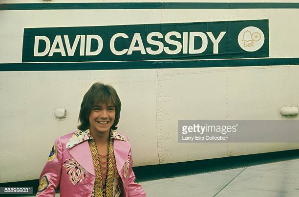 American actor singer songwriter and guitarist David Cassidy with his private plane circa 1975