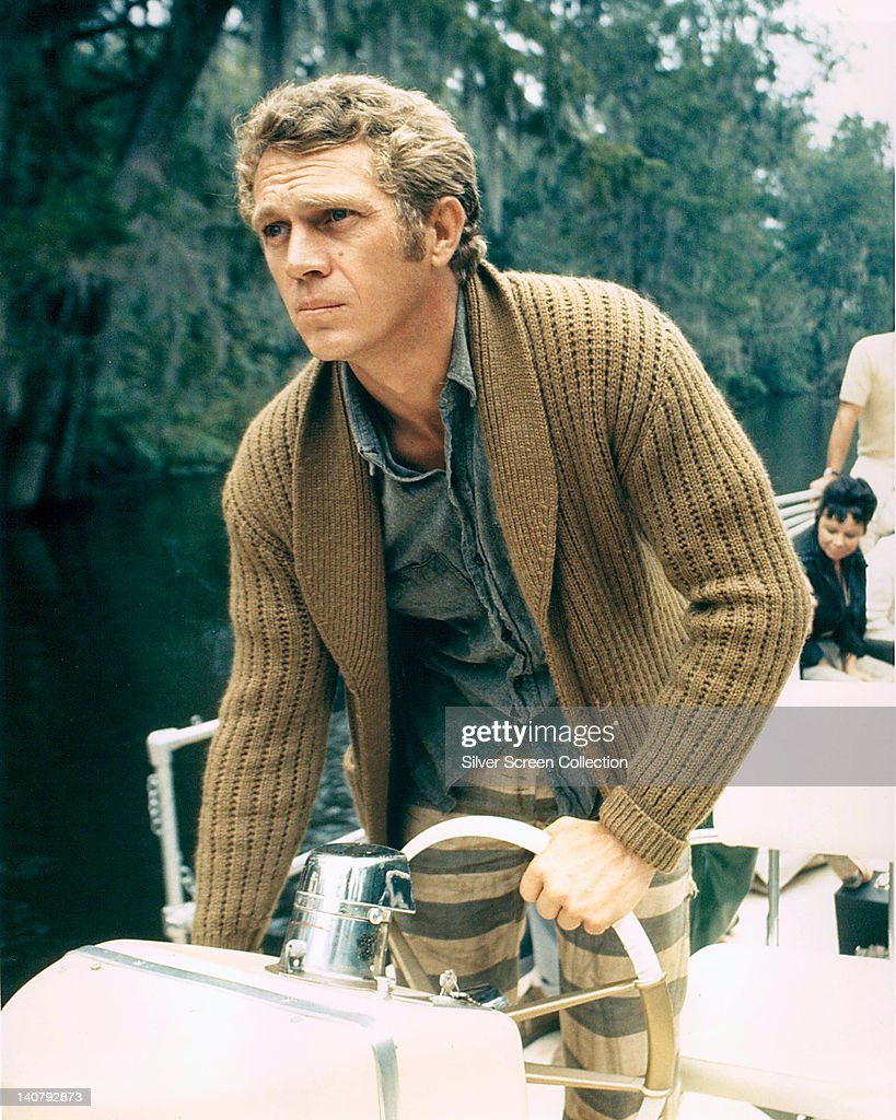 <a gi-track='captionPersonalityLinkClicked' href=/galleries/search?phrase=Steve+McQueen+-+Actor&family=editorial&specificpeople=217797 ng-click='$event.stopPropagation()'>Steve McQueen</a> (1930-1980), US actor, wearing a brown cardigan as he stands at the wheel of a boat, circa 1965.