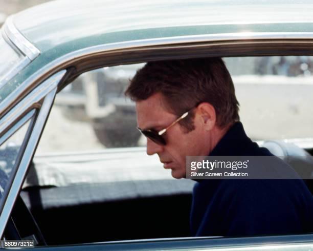 American actor Steve McQueen sits in a car in a scene from 'Bullitt' California 1968