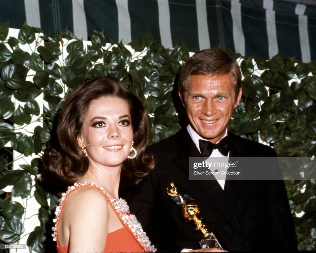 American actor Steve McQueen (1930 -1980) winner of the 'Henrietta Award for World Film Favorite-Male' with Natalie Wood (1938 - 1981) at the 24th Annual Golden Globe Awards at the Cocoanut Grove on February 15, 1967.