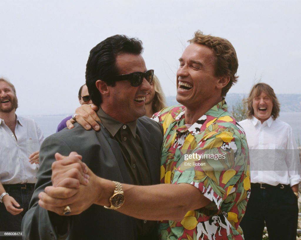 American actor Sylvester Stallone and Austrian born actor, Arnold Schwarzenegger dancing for a joke, during the 43th International Cannes Film Festival.