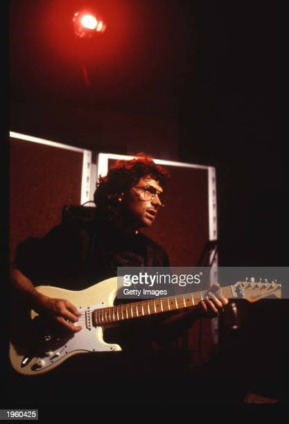 American actor Tim Daly plays a guitar on the set of the TV movie 'In the line of fire Ambush in Waco' on location Tulsa Oklahoma 1993
