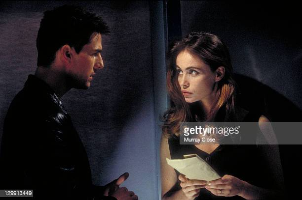 American actor Tom Cruise as Ethan Hunt and French actress Emmanuelle Beart as Claire Phelps in a scene from the film 'Mission Impossible' 1996