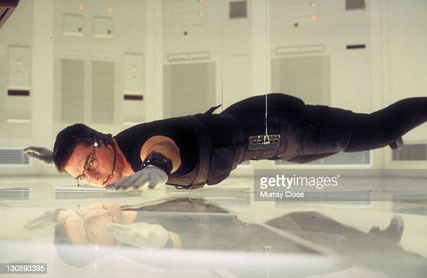American actor Tom Cruise as Ethan Hunt in a scene from the film 'Mission Impossible' 1996 Here he steals the NOC list from the CIA headquarters in...