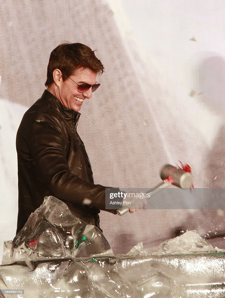 American actor <a gi-track='captionPersonalityLinkClicked' href=/galleries/search?phrase=Tom+Cruise&family=editorial&specificpeople=156405 ng-click='$event.stopPropagation()'>Tom Cruise</a> breaks an ice sculpture to wish for over 100 million box office at the Taiwan premiere of 'Oblivion' on April 6, 2013 in Taipei, Taiwan.