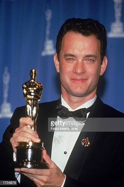 American actor Tom Hanks holds up the Oscar statuette he won for Best Actor for his role in the film 'Philadelphia' Academy Awards Dorothy Chandler...